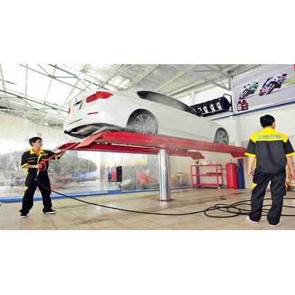 Cầu nâng rửa xe ô tô 1 trụ hinh anh 1